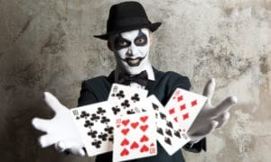 scary clown with playing cards