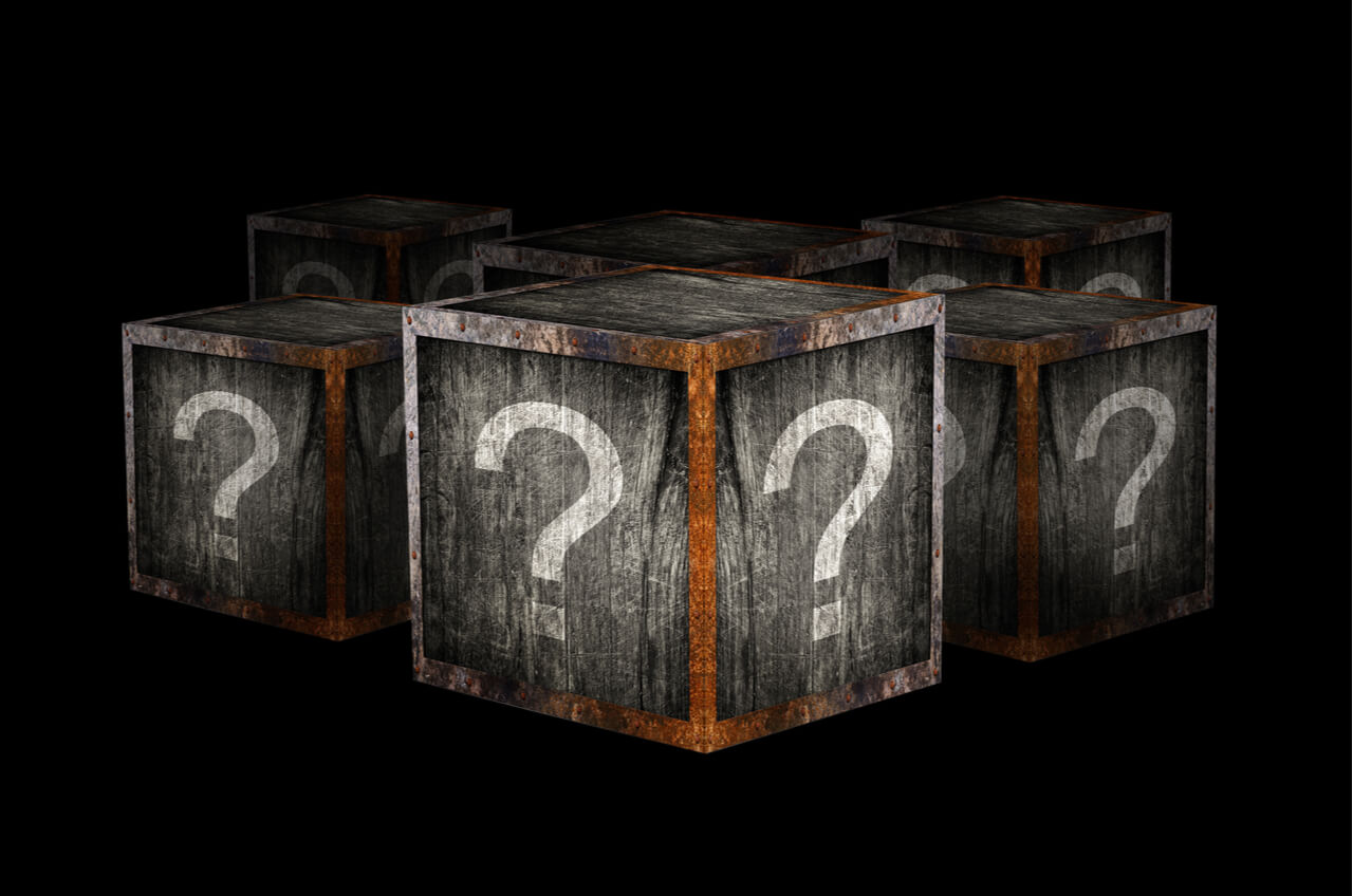 wooden boxes with question marks